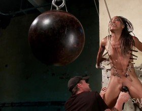 Hot young slut in brutal bondage