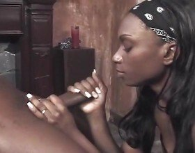 Ebony Babe Sucks On A Black Dick