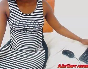 Cute African cam girl takes her